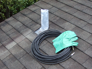 Clearing a Clogged Drain from a Roof Vent